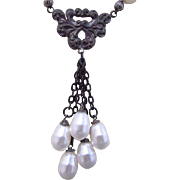A Five Swarovski Crystal Faux Pearl Teardrop Focal Necklace