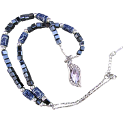 A Violet Crystal Horse Eye Pendant and Glass Bead Necklace and Earrings
