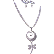 A Metal Circle Swirled Pendant and Austrian Crystal Dragonfly Necklace and Earrings