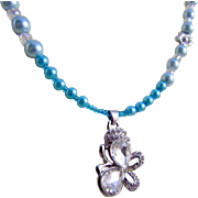 An Austrian Crystal Butterfly Pendant and Blue Glass Pearl Necklace & Earrings