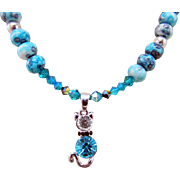 A Crystal and Metal Kitty Kat Pendant with Blue Rainbow Agate Necklace and Earrings