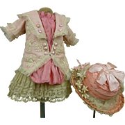 French couturier pink silk, satin and patterned gauze antique dolls dress with matching pink .