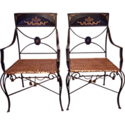 A Pair of Mid-Century French Black Iron Chairs with Gold Scroll Detailing and Rattan ...