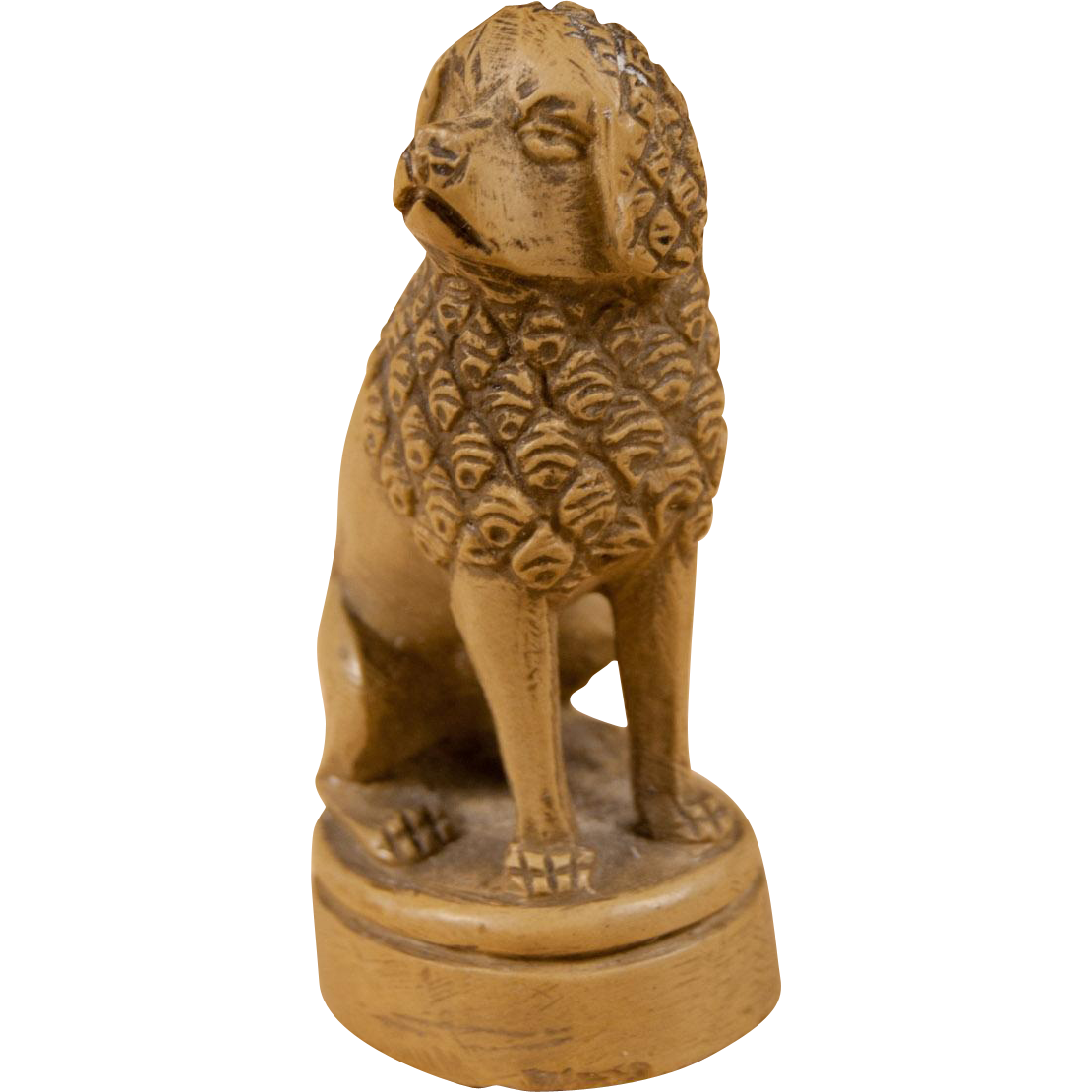 A small carved stone dog