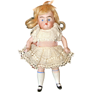 Painted Eye All Bisque Child Doll