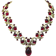 SALE A signed Trifari 'Renaissance' gold tone drop necklace of Ruby red gripoix cabochon stone