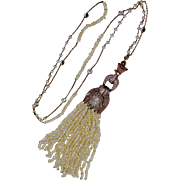 A Freshwater Seed Pearl and White Topaz Necklace with a detachable Panther Head Pearl Tassel