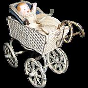 German bisque baby with vintage German metal carriage