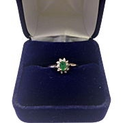 Genuine Emerald Ring with diamond accents and 10K Yellow Gold