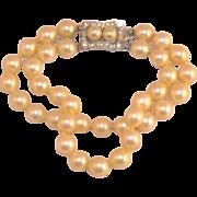 Lustrous Vendome Double Strand Simulated Pearls Bracelet - Rhinestone Clasp