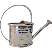 Your potted violets will be envious – CARTIER sterling watering can vermouth dispenser