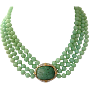 Vintage Nolan Miller green Peking glass necklace with faux jade pendant