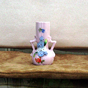 Pink German Elfin ware vase with 2 handles and blue flowers