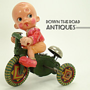 Celluloid and Tin Boy on Tricycle Bell-ringer Wind-up Toy