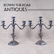 Silver Plated Candelabras with Winged Cupids Holding Bow (Pair) -  1890's