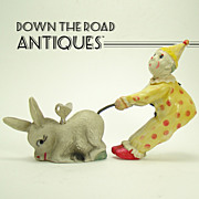 Early Celluloid Clown Pulling Donkey Tail Wind-up Toy 1940s