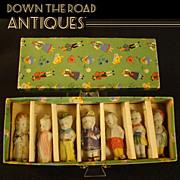 Bisque Dolls in Original Box (Set of Seven)