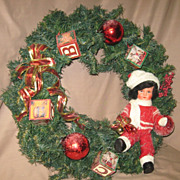 SALE German paper mache doll in a Christmas Wreath