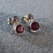 Sterling Silver Post Style Earrings with Round Garnet Accents **