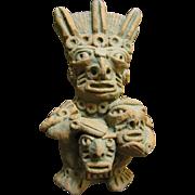 Primitive Clay Figurine of the Peruvian Moche God Ai-Apec with Decapitated Heads (No 1)