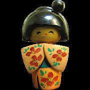 Pretty Kokeshi Doll with Ornate Kimono and Stylized Hair