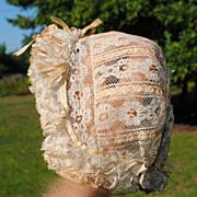 SALE Beautiful Ecru Lace Bonnet With Beige Silk Ribbons...Circa 1890