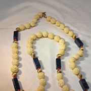 Carved Bone and blue beaded necklace gold tone spacers