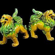 Two Porcelain Sancai Glazed Foo Lions/Dogs