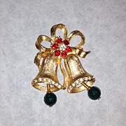 Stunning vintage gold tone bell pin rhinestone brooch