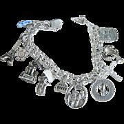 SALE VALENTINE'S..Vintage Sterling 11 Charms Link Bracelet