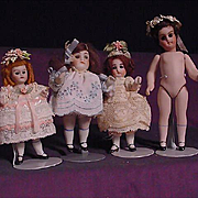 REDUCED Four All Bisque Dolls With Glass Eyes