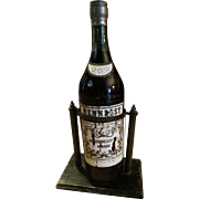 Antique Hennessy Bottle early 20th century with original stand