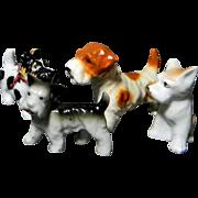 4 Occupied Japan Puppy Dog Figurines