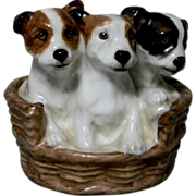 Three Puppies in a Basket by Royal Doulton