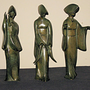 Three Stylized Japanese Female Geisha Statues