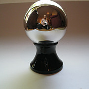 Vintage Silver Mercury Glass Ball on a Black Depression Glass Base