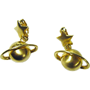 Unique Gold-Toned Earrings with Saturn Hanging from a Star