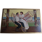 Postcard of Couple Sitting On A Hammock""