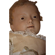 SALE PENDING Antique Doll Poured Wax Baby in Swaddling Cloth Glass Eyes Wonderful