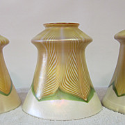 A set of three Quezal shades