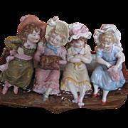 A rare KPM Kister log vase with 4 girls