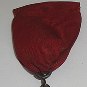 SOLD Vintage Winged Woman Angel Medal with Red Ribbon