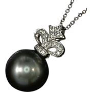 Fleur de Lis 18 Karat White Gold Diamond Studded Pendant with a  Dangling Cultured Salt Water