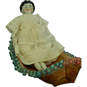 Tiny all original antique china head doll with her Iroquois whimsy boat