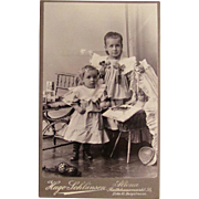 Photo of Sisters with Loads of Toys Cabinet Card