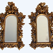 Pair of Italian Carved Gilt Rococo Mirrors.