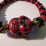 Chinese Red Smiling Buddha Charm with Black Onyx and Red Saucer Bead Bracelet