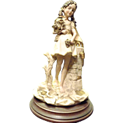 Reduced 25%~ Capdimonte Girl Figurine- Done in Flesh, White, Gold and Beige on Wooden Pedestal