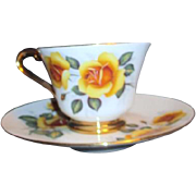 Yellow Roses Cup and Saucer by Audre with Rotary Symbol
