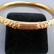 Handsome Victorian hinged gold filled bracelet, repousee and chasing